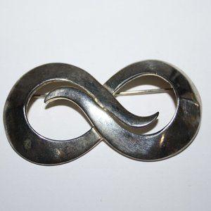 Silver infinity M Jent brooch
